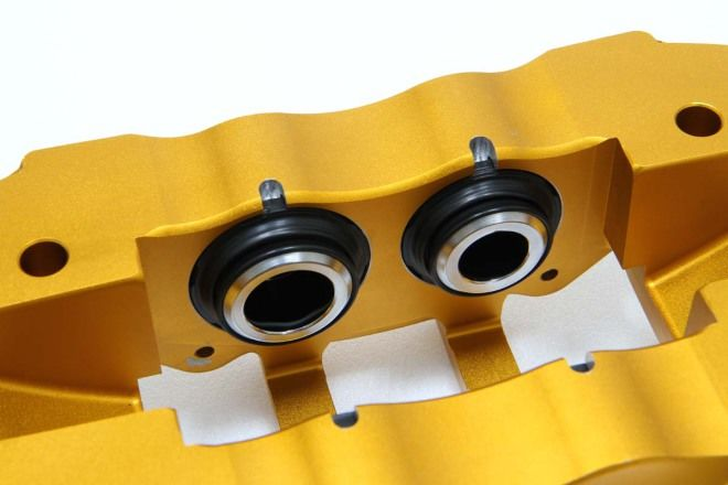 為何多活塞卡鉗的活塞上設有防塵套?什麼作用呢?